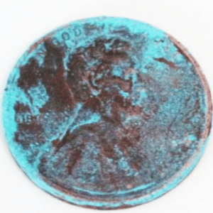 Image of a heavily patinaed penny