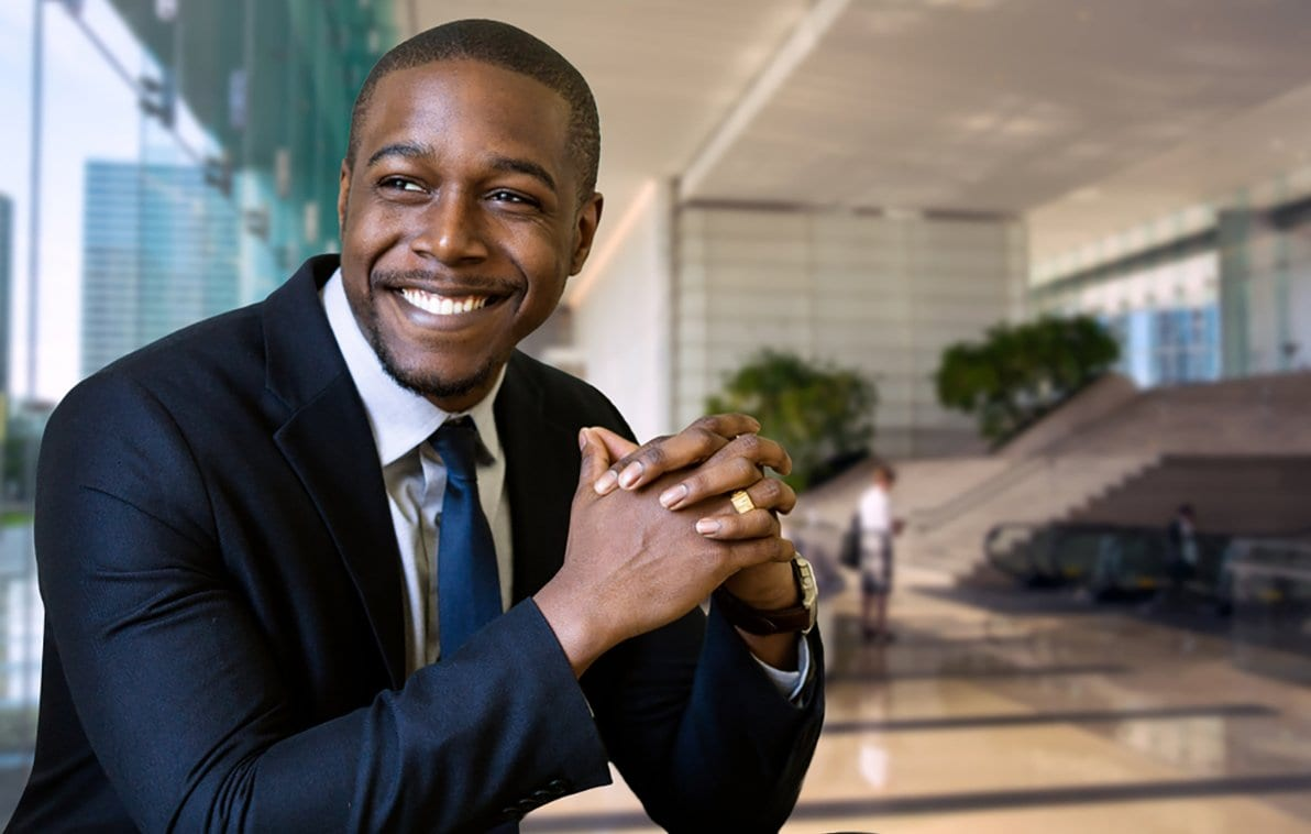 Photo of a young businessman smiling